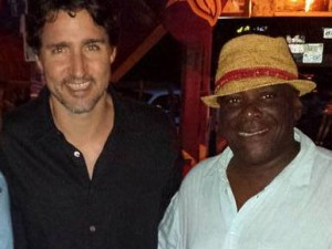 PM Trudeau with Sunshine of the world famous Sunshine's Bar and Grill on Nevis